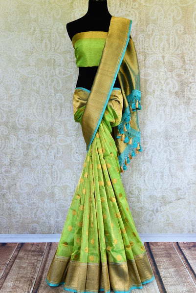 Buy green tissue Banarasi sari online at Pure Elegance. Our Indian fashion store brings a stunning range of woven Banarasi sarees in USA for weddings and festive occasions.-full view