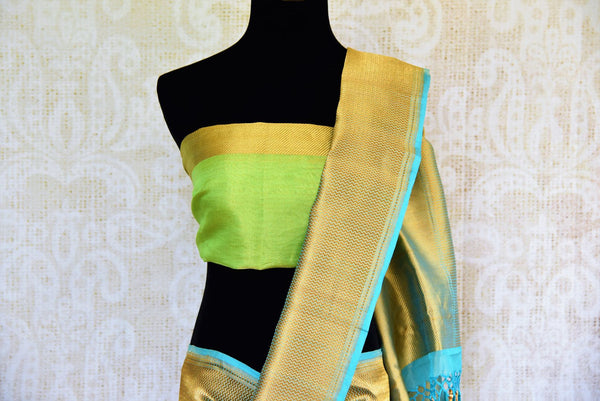 Buy green tissue Banarasi sari online at Pure Elegance. Our Indian fashion store brings a stunning range of woven Banarasi sarees in USA for weddings and festive occasions.-pallu