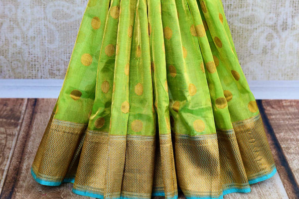 Buy green tissue Banarasi sari online at Pure Elegance. Our Indian fashion store brings a stunning range of woven Banarasi sarees in USA for weddings and festive occasions.-pleats