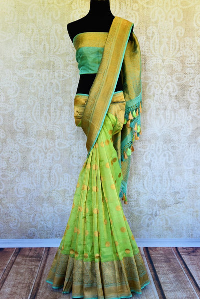 Buy ethnic green tissue Banarasi saree online at Pure Elegance. Our Indian fashion store brings a stunning range of traditional Banarasi sarees in USA for weddings.-full view
