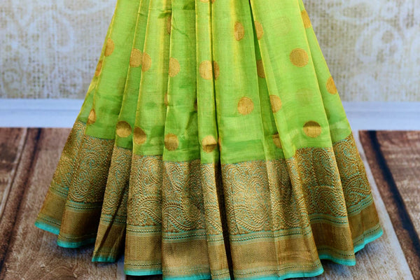 Buy ethnic green tissue Banarasi saree online at Pure Elegance. Our Indian fashion store brings a stunning range of traditional Banarasi sarees in USA for weddings.-pleats