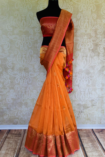 Buy orange Kora Banarasi saree online at Pure Elegance. Our Indian fashion store brings a stunning range of traditional Banarasi sarees in USA for festivals and weddngs.-full view