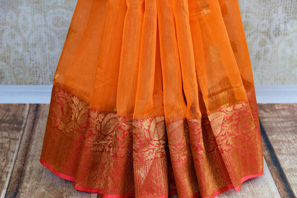 Buy orange Kora Banarasi saree online at Pure Elegance. Our Indian fashion store brings a stunning range of traditional Banarasi sarees in USA for festivals and weddngs.-pleats