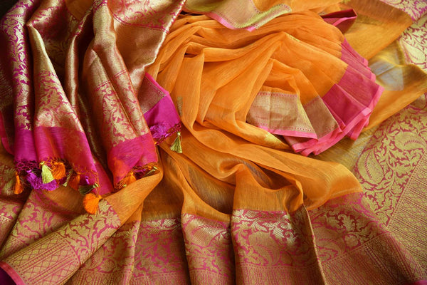 Buy orange Kora Banarasi saree online at Pure Elegance. Our Indian fashion store brings a stunning range of traditional Banarasi sarees in USA for festivals and weddngs.-details
