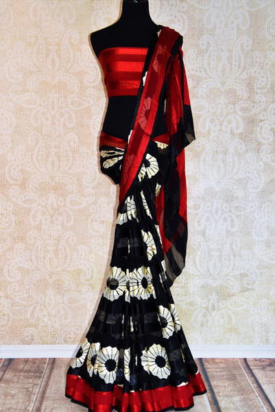 Buy black and white printed crepe silk saree online in USA with red border.. Pure Elegance fashion store brings you a stunning range of Indian designer sarees in USA.-full view