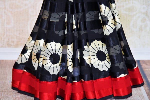 Buy black and white printed crepe silk saree online in USA with red border.. Pure Elegance fashion store brings you a stunning range of Indian designer sarees in USA.-pleats