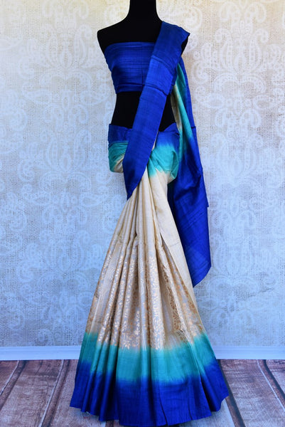 Buy off-white and blue khari print tassar saree online in USA. Pure Elegance clothing store brings an exquisite variety of Indian woven tussar sarees in USA for women.-full view