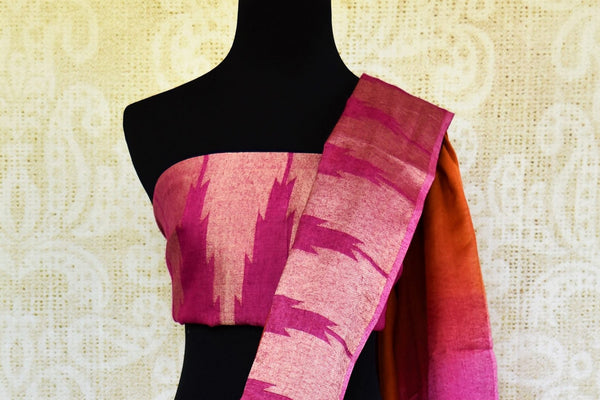 Buy orange and pink linen sari with temple border online in USA. Pure Elegance clothing store brings an exquisite range of Indian woven linen sarees in USA. Shop online.-blouse pallu