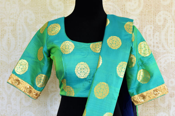 Buy green and blue embroidered silk saree with Benarasi border online in USA. Pure Elegance clothing store brings an exquisite range of Indian designer sarees online in USA. -blouse pallu