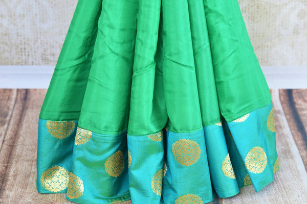 Buy green and blue embroidered silk saree with Benarasi border online in USA. Pure Elegance clothing store brings an exquisite range of Indian designer sarees online in USA.  -pleats