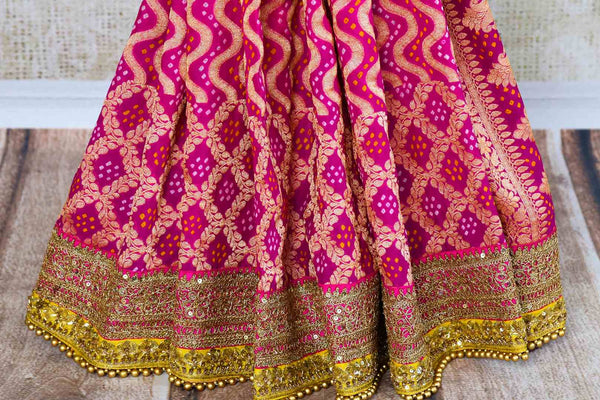 Buy yellow and pink tussar georgette Banarasi embroidered saree online in USA. Pure Elegance clothing store brings an exquisite range of Indian designer sarees online in USA. -pleats