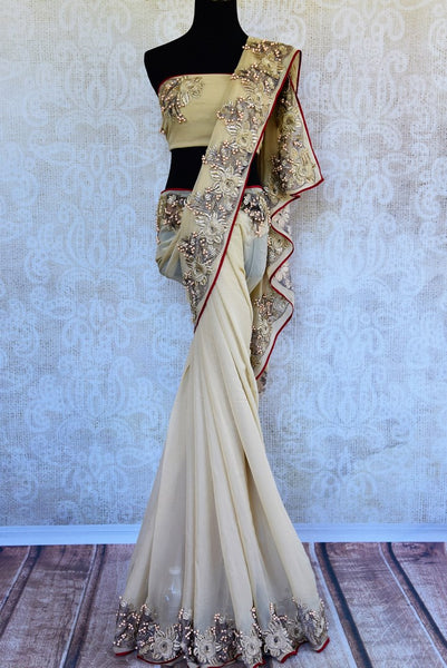 Buy beige embroidered georgette saree online in USA. Pure Elegance clothing store brings an exquisite range of Indian designer wedding sarees in USA for women. -full view