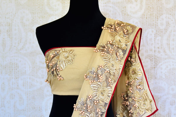 Buy beige embroidered georgette saree online in USA. Pure Elegance clothing store brings an exquisite range of Indian designer wedding sarees in USA for women.  -blouse pallu