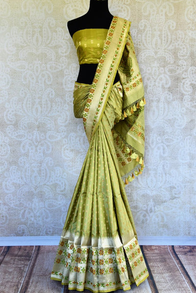 Buy green Banarasi resham saree online in USA. Pure Elegance clothing store brings exclusively curated collection of Indian Banarasi sarees for weddings in USA. -full view