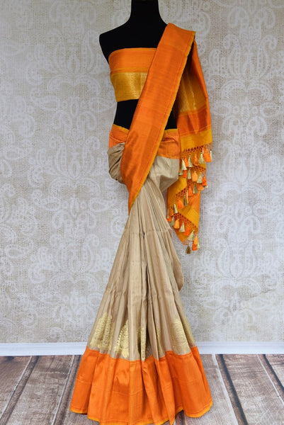 Buy beige tussar khaddi Banarasi saree online in USA. Pure Elegance clothing store brings an exquisite variety of Indian Banarasi saris for online shopping in USA. -closeup