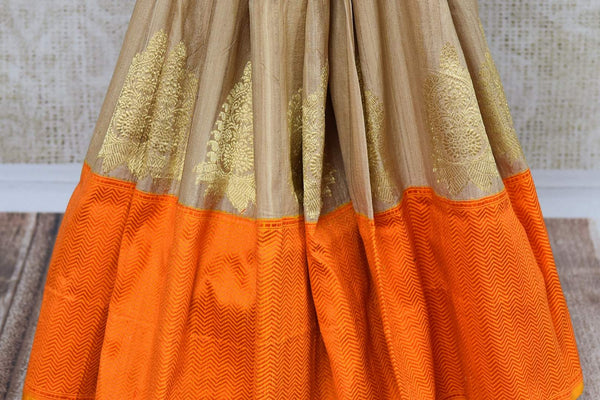 Buy beige tussar khaddi Banarasi saree online in USA. Pure Elegance clothing store brings an exquisite variety of Indian Banarasi saris for online shopping in USA. -pleats