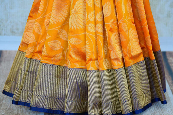 Buy beautiful orange kathan silk Banarasi saree online in USA. Pure Elegance clothing store brings an exquisite variety of Indian silk sarees for weddings in USA for women.  -pleats