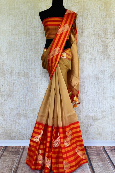 Buy brown tissue Banarasi saree with striped border online in USA. Pure Elegance clothing store brings exquisite range of Indian Benarasi sarees for online shopping in USA.-full view