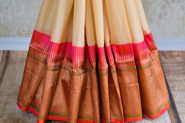 Buy off white linen Banarasi saree with zari border online in USA. Pure Elegance fashion store brings an exquisite range of Indian wedding sarees in USA for women. -pleats