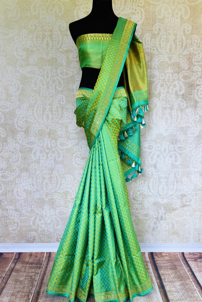 Buy pastel green Banarasi silk saree online in USA. Pure Elegance fashion store brings a stunning range of Indian designer sarees for weddings and festivals in USA.-full view