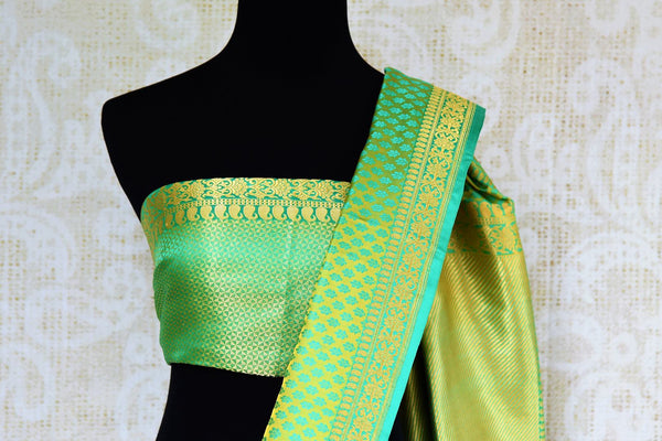 Buy pastel green Banarasi silk saree online in USA. Pure Elegance fashion store brings a stunning range of Indian designer sarees for weddings and festivals in USA.-blouse pallu