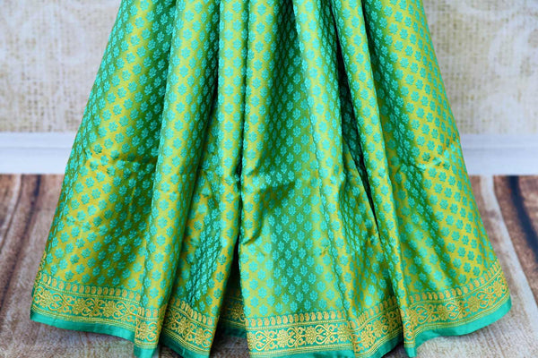 Buy pastel green Banarasi silk saree online in USA. Pure Elegance fashion store brings a stunning range of Indian designer sarees for weddings and festivals in USA.-pleats