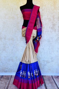 Buy cream and blue tussar silk Benarasi silk saree online in USA. Pure Elegance clothing store brings exquisite range of Indian Benarasi sarees for online shopping in USA.-full view