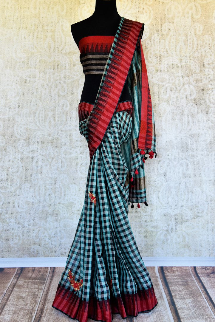 Buy green and black checker embroidered linen saree online in USA. Pure Elegance clothing store brings an exquisite range of Indian woven linen sarees online in USA.-full view