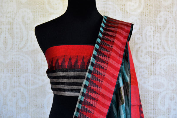 Buy green and black checker embroidered linen saree online in USA. Pure Elegance clothing store brings an exquisite range of Indian woven linen sarees online in USA.-blouse pallu