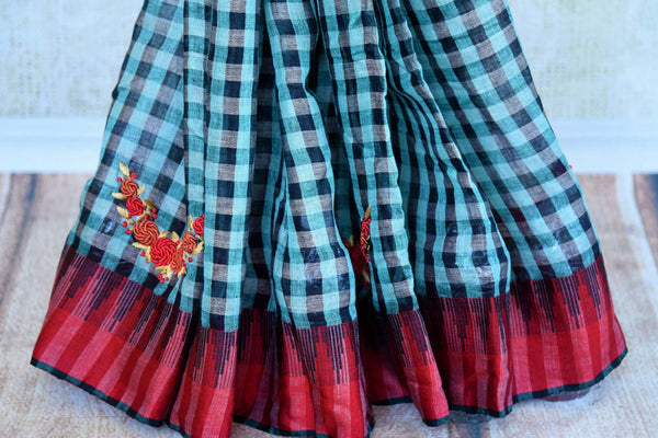 Buy green and black checker embroidered linen saree online in USA. Pure Elegance clothing store brings an exquisite range of Indian woven linen sarees online in USA.-pleats