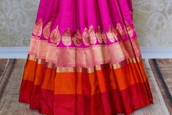 Buy bright pink Banarasi silk saree online in USA. Pure Elegance fashion store brings an exquisite collection of Indian designer sarees in USA for weddings and festivals.-pleats