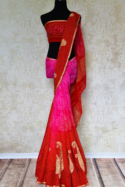 Buy pink and red Banarasi chiffon saree online in USA with bandhej print. Pure Elegance fashion store brings exquisite collection of Indian designer saris in USA.-full view
