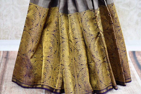 Buy grey kanchipuram silk saree with zari border online in USA. Pure Elegance clothing store brings an exquisite variety of Indian Kanchipuram silk sarees in USA. Shop online.-pleats