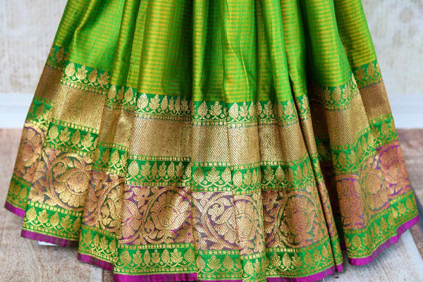 Buy ethnic green tussar Banarasi saree online in USA. Pure Elegance clothing store brings an exquisite collection of Indian wedding sarees in USA for women. Shop online.-pleats
