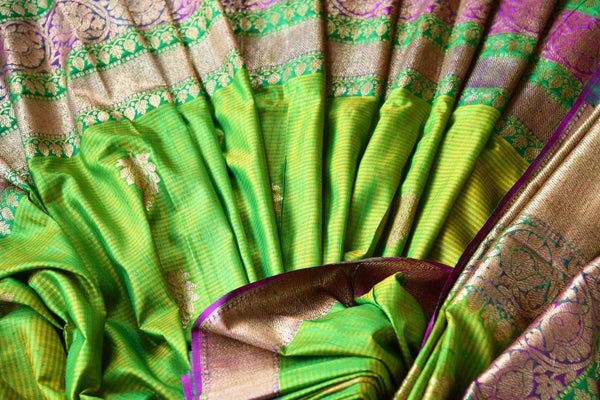Buy ethnic green tussar Banarasi saree online in USA. Pure Elegance clothing store brings an exquisite collection of Indian wedding sarees in USA for women. Shop online.-details