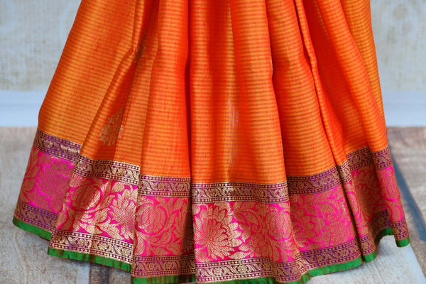 Buy ethnic orange tussar Banarasi saree online in USA. Pure Elegance clothing store brings an exquisite collection of Indian woven sarees in USA for women. Shop online.-pleats