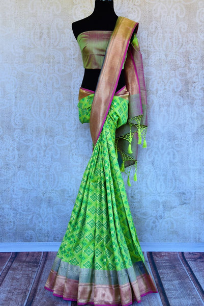 Buy bright green tussar Banarasi sari online in USA. Pure Elegance clothing store brings an exquisite variety of Indian woven Banarasi sarees in USA. Shop online.-full view