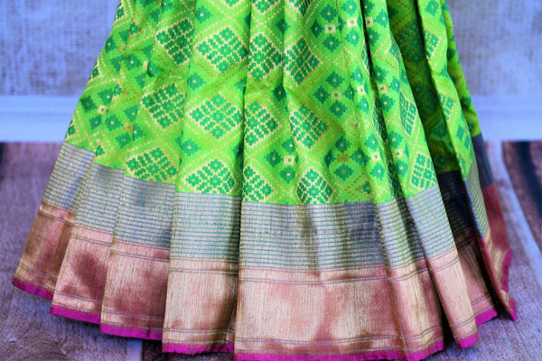 Buy bright green tussar Banarasi sari online in USA. Pure Elegance clothing store brings an exquisite variety of Indian woven Banarasi sarees in USA. Shop online.-pleats
