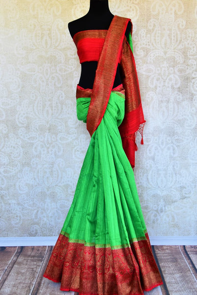 Buy green tussar Banarasi saree with red zari border online in USA. Pure Elegance clothing store brings an exquisite variety of Indian woven Banarasi saris in USA. -full view