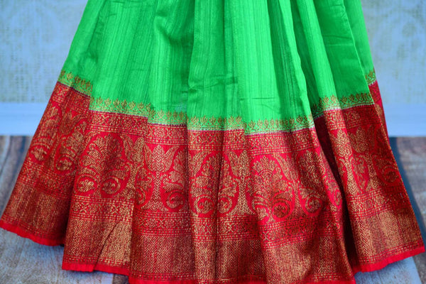Buy green tussar Banarasi saree with red zari border online in USA. Pure Elegance clothing store brings an exquisite variety of Indian woven Banarasi saris in USA. -pleats