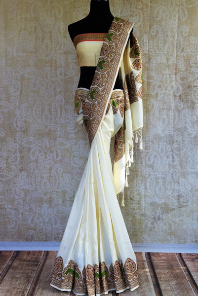 Buy off white muga Banarasi saree online in USA. Choose from a range of exquisite Indian Banarasi woven sarees for weddings from Pure Elegance fashion store in USA.-full view