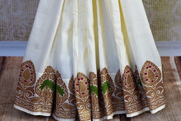 Buy off white muga Banarasi saree online in USA. Choose from a range of exquisite Indian Banarasi woven sarees for weddings from Pure Elegance fashion store in USA.-pleats