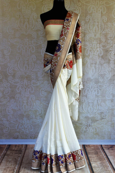 Buy off white muga Banarasi sari online in USA. Choose from a range of exquisite Indian Banarasi sarees for weddings from Pure Elegance fashion store in USA.-full view