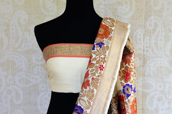 Buy off white muga Banarasi sari online in USA. Choose from a range of exquisite Indian Banarasi sarees for weddings from Pure Elegance fashion store in USA.-blouse pallu