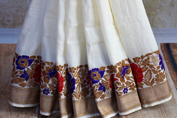 Buy off white muga Banarasi sari online in USA. Choose from a range of exquisite Indian Banarasi sarees for weddings from Pure Elegance fashion store in USA.-pleats