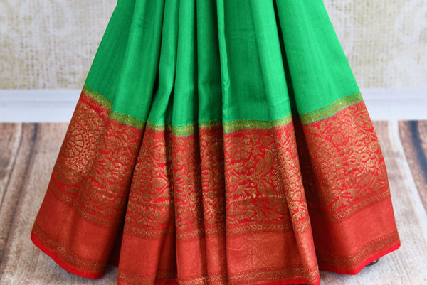 Buy green muga Banarasi saree with red zari border online in USA. Choose from an alluring range of Indian ethnic Banarasi sarees at Pure Elegance fashion store in USA.-pleats
