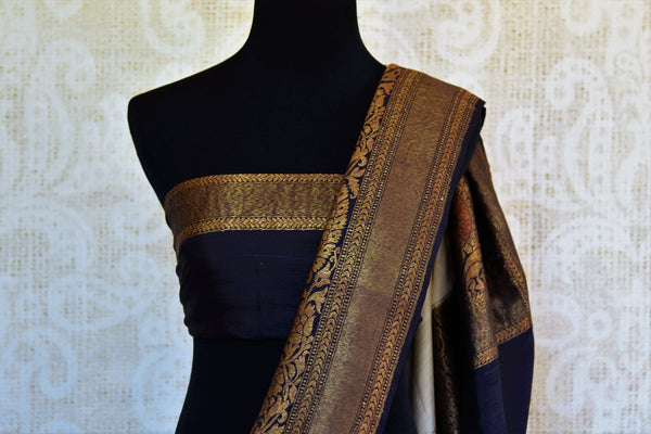Buy off white muga Banarasi saree with black zari border online in USA. Choose from a range of exquisite ethnic Indian woven sarees from Pure Elegance store in USA.-blouse pallu