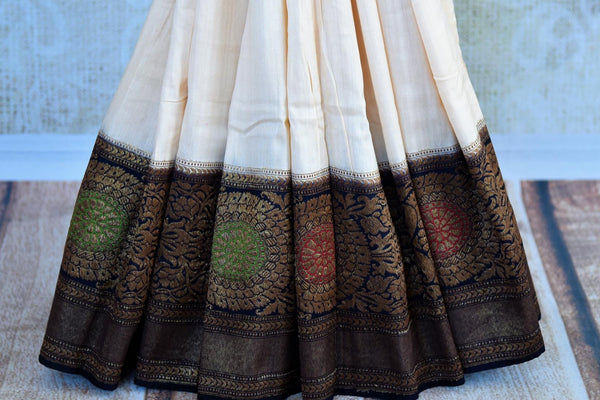 Buy off white muga Banarasi saree with black zari border online in USA. Choose from a range of exquisite ethnic Indian woven sarees from Pure Elegance store in USA.-pleats