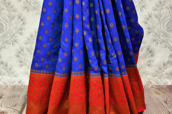 Buy online blue tassar Banarasi saree with zari border in USA at Pure Elegance. Choose from traditional Indian Banarasi woven sarees from our fashion store in USA.-pleats