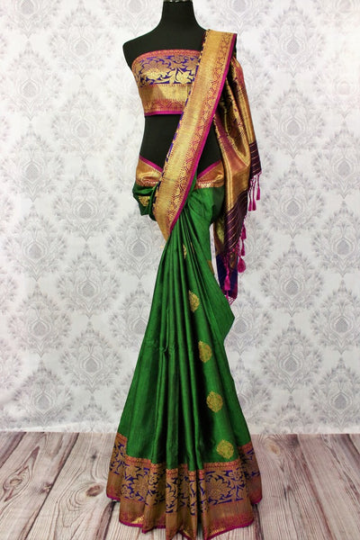 Buy online green tassar Banarasi saree with zari border in USA at Pure Elegance. Choose from traditional Indian Banarasi woven saris from our fashion store in USA.-full view